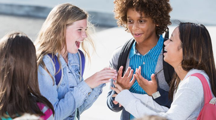 Middle School Students Laughing Together